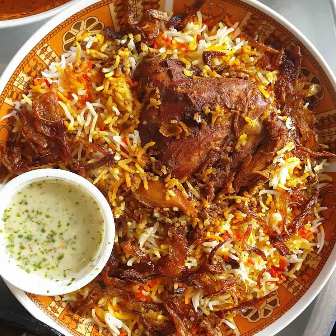مطعم اضواء النافورة رز بخاري ومشويات